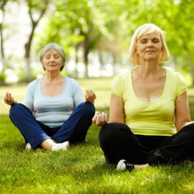 Portrait of aged women doing yoga exercise